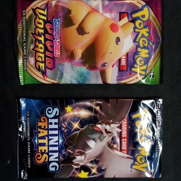 2 booster packs of cards